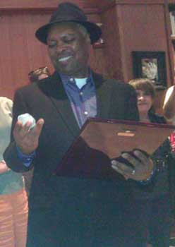 Dr. Booker T. Jones received an SAI Craftsmanship Award plaque and a native Indiana geode.