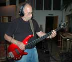 Photo of Henry Corning playing bass guitar.