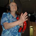 Photo of Kathy Schick playing tambourine.