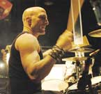 Photo of Kenny Aranoff playing drums.