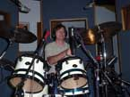 Photo of Tom Schoenemann playing drums.
