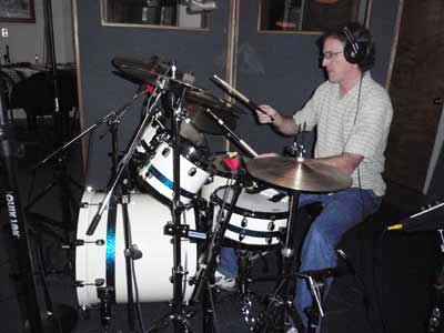 Tom on drums.